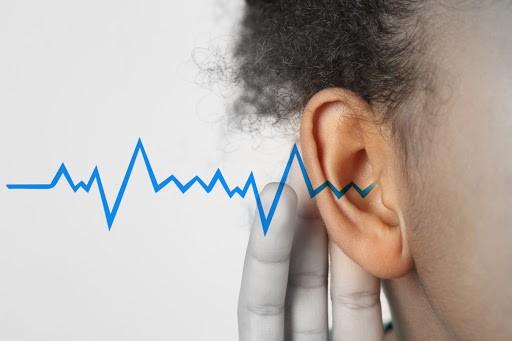 Oído con onda sonora